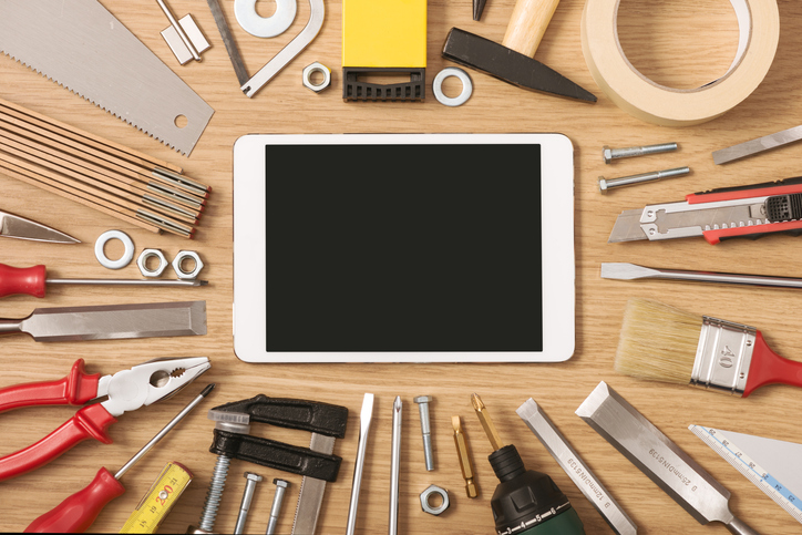 Digital touch screen banner with DIY and work tools all around on a wooden table, top view